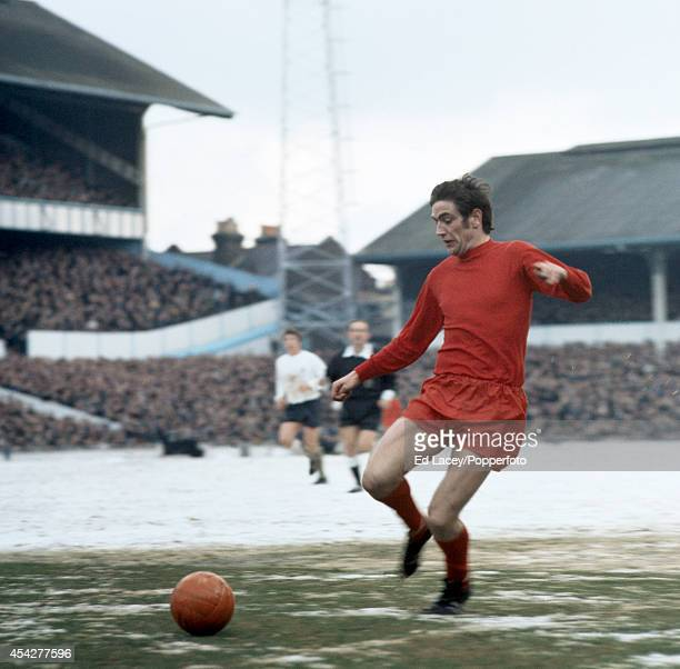 Norman Hunter in action on a snowy pitch for Leeds United against Tottenham Hotspur during their Division One football match at White Hart Lane in...