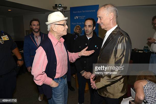 Norman Lear Nayib Estefan and John Waters attends the Miami International Book Fair at Miami Dade College on November 21 2014 in Miami Florida