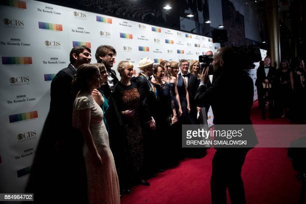 Norman Lear poses with his family while arriving for the 40th Kennedy Center Honors December 3 2017 in Washington DC / AFP PHOTO / Brendan Smialowski