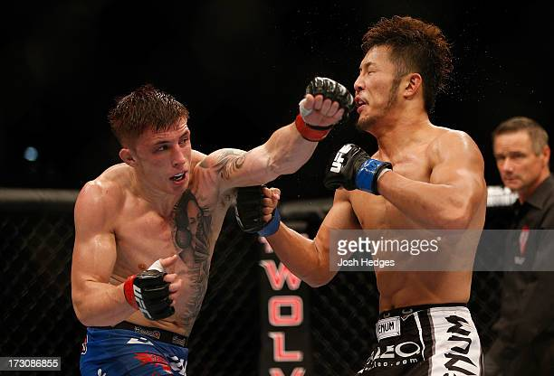 Norman Parke punches Kazuki Tokudome in their lightweight fight during the UFC 162 event inside the MGM Grand Garden Arena on July 6 2013 in Las...