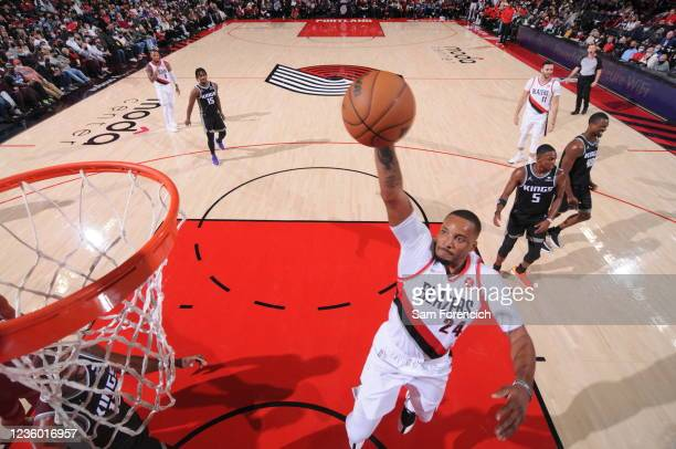 Norman Powell of the Portland Trail Blazers dunks the ball during the game against the Sacramento Kings on October 20, 2021 at the Moda Center Arena...