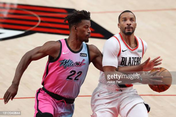 Norman Powell of the Portland Trail Blazers is fouled by Jimmy Butler of the Miami Heat in the third quarter at Moda Center on April 11, 2021 in...