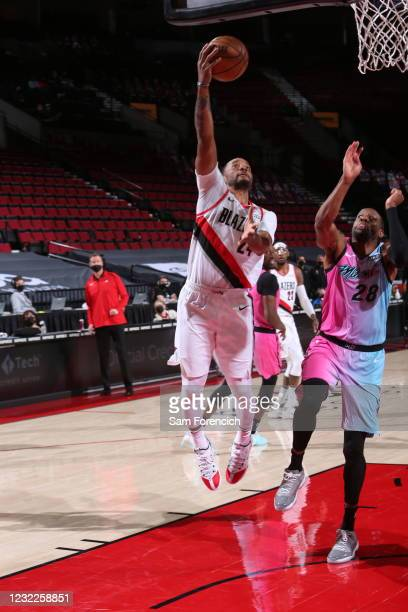 Norman Powell of the Portland Trail Blazers shoots the ball during the game against the Miami Heat on April 11, 2021 at the Moda Center Arena in...