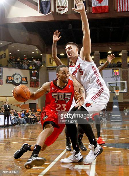 Norman Powell of the Raptors 905 drives to the basket against Byron Mullens of the Sioux Falls Skyforce at the Sanford Pentagon December 22 2015 in...