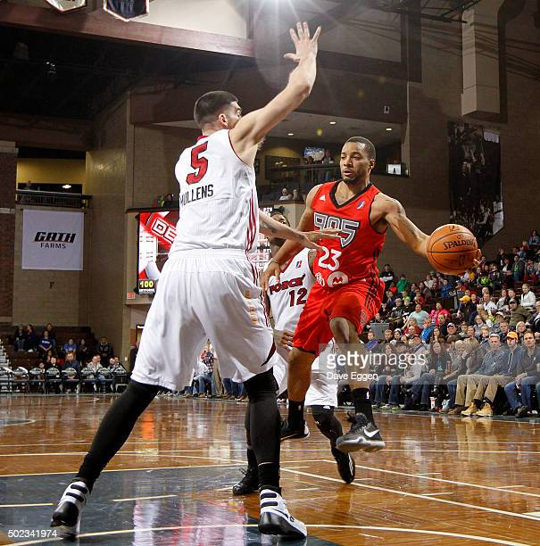 Norman Powell of the Raptors 905 passes the ball around Byron Mullens of the Sioux Falls Skyforce at the Sanford Pentagon December 22 2015 in Sioux...