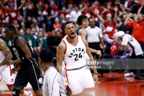 Norman Powell of the Toronto Raptors celebrates after scoring during the game against the Milwaukee Bucks during Game Five of the Eastern Conference...