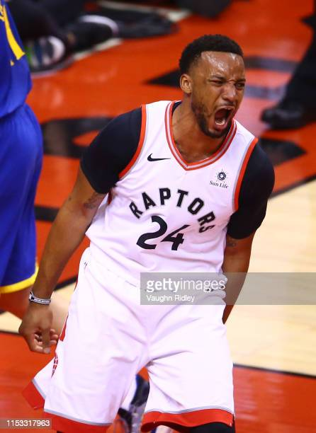 Norman Powell of the Toronto Raptors celebrates his dunk against the Golden State Warriors in the first half during Game Two of the 2019 NBA Finals...
