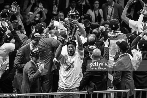 Norman Powell of the Toronto Raptors celebrates on stage with the Larry O'Brien Trophy after winning Game Six of the NBA Finals against the Golden...