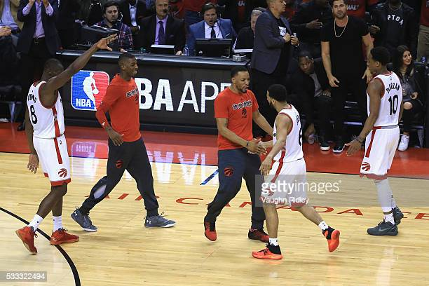 Norman Powell of the Toronto Raptors congratulates Cory Joseph after a made threepoint basket during the second half against the Cleveland Cavaliers...