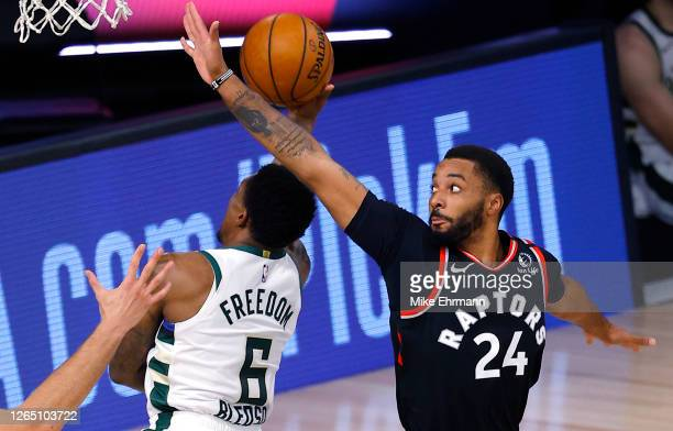 Norman Powell of the Toronto Raptors defends against Eric Bledsoe of the Milwaukee Bucks during the third quarter at The Field House at ESPN Wide...