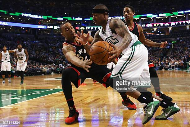 Norman Powell of the Toronto Raptors defends Isaiah Thomas of the Boston Celtics during the third quarter at TD Garden on March 23 2016 in Boston...