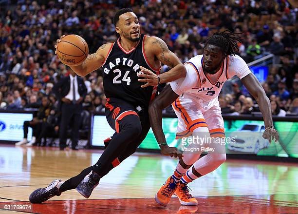 Norman Powell of the Toronto Raptors dribbles the ball as Maurice Ndour of the New York Knicks defends during the second half of an NBA game at Air...