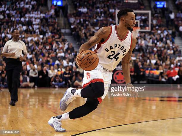 Norman Powell of the Toronto Raptors dribbles the ball during an NBA game against the Detroit Pistons at Air Canada Centre on October 26 2016 in...