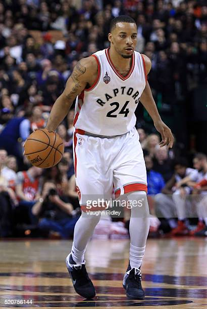 Norman Powell of the Toronto Raptors dribbles the ball during the second half of an NBA game against the Philadelphia 76ers at the Air Canada Centre...
