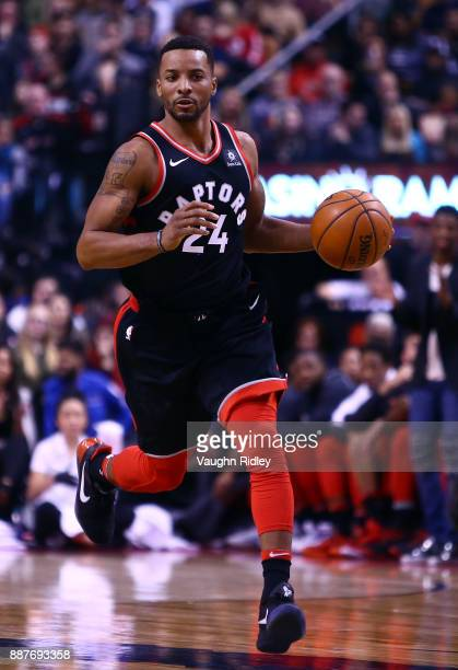 Norman Powell of the Toronto Raptors dribbles the ball during the second half of an NBA game against the Indiana Pacers at Air Canada Centre on...