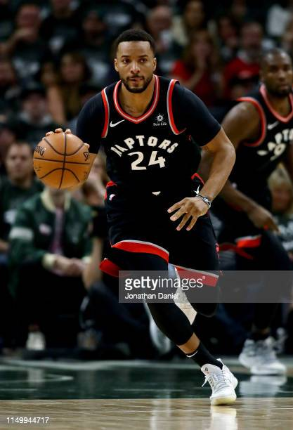 Norman Powell of the Toronto Raptors dribbles the ball in the second quarter against the Milwaukee Bucks during Game Two of the Eastern Conference...