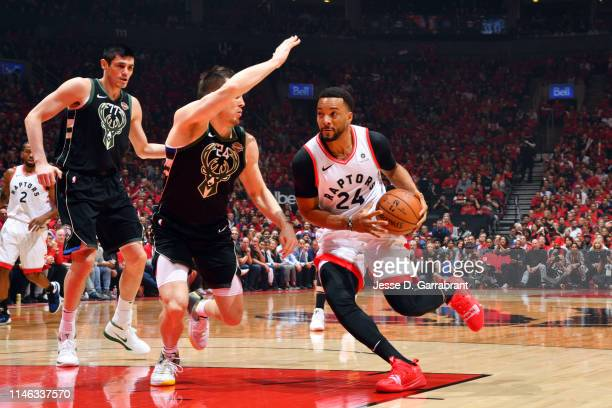Norman Powell of the Toronto Raptors drives to the basket against the Milwaukee Bucks during Game Six of the Eastern Conference Finals on May 25 2019...