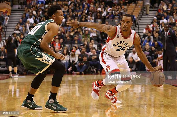Norman Powell of the Toronto Raptors drives to the basket against the Milwaukee Bucks during the game on November 1 2015 at the Air Canada Centre in...