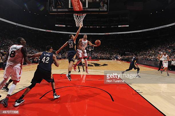 Norman Powell of the Toronto Raptors drives to the basket against the New Orleans Pelicans on November 13 2015 at the Air Canada Centre in Toronto...