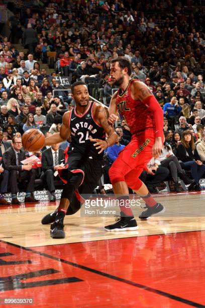 Norman Powell of the Toronto Raptors drives to the basket against the Atlanta Hawks on December 29 2017 at the Air Canada Centre in Toronto Ontario...