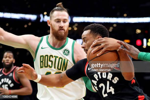Norman Powell of the Toronto Raptors drives to the basket past Aron Baynes of the Boston Celtics in the second quarter of a game at TD Garden on...