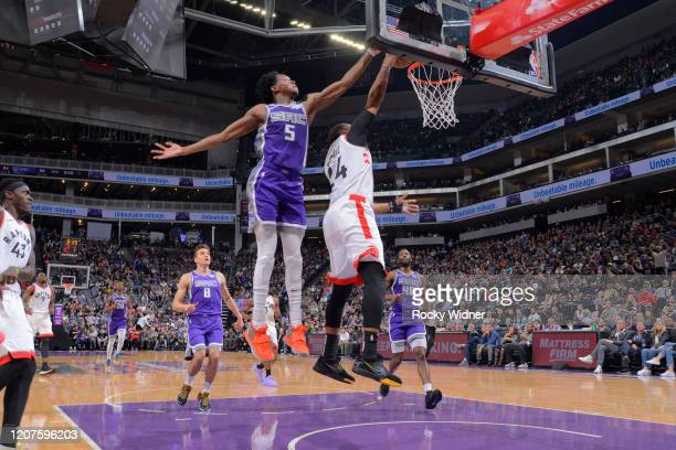 Norman Powell of the Toronto Raptors dunks against De'Aaron Fox of the Sacramento Kings on March 8 2020 at Golden 1 Center in Sacramento California...
