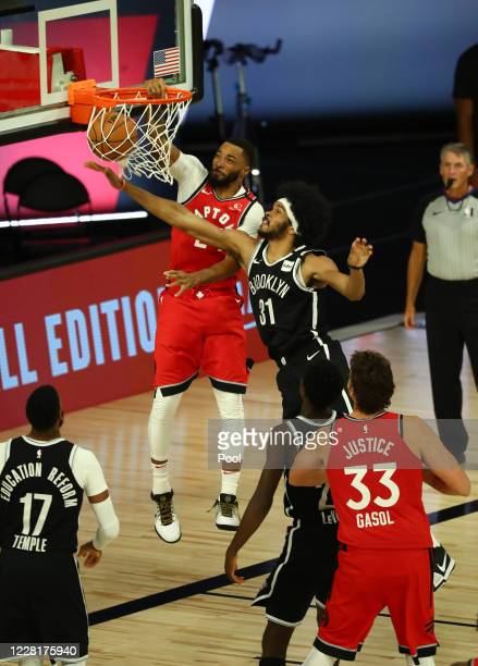 Norman Powell of the Toronto Raptors dunks against the Jarrett Allen of the Brooklyn Nets during the second half in game four of the first round of...