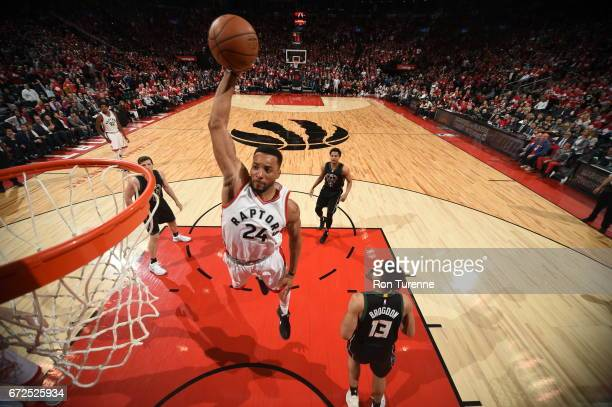 Norman Powell of the Toronto Raptors dunks against the Milwaukee Bucks in Game Five of the Eastern Conference Quarterfinals during the 2017 NBA...