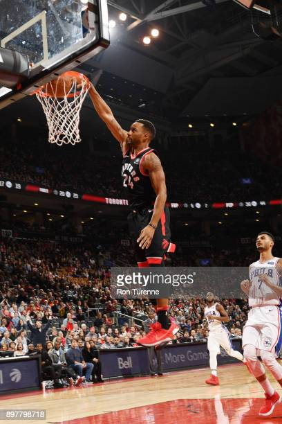 Norman Powell of the Toronto Raptors dunks against the Philadelphia 76ers on December 23 2017 at the Air Canada Centre in Toronto Ontario Canada NOTE...