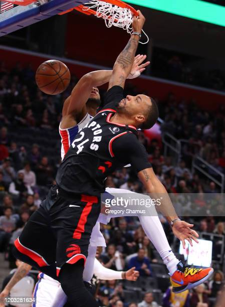 Norman Powell of the Toronto Raptors dunks past Bruce Brown of the Detroit Pistons during the second half at Little Caesars Arena on January 31 2020...