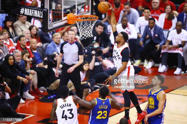 Norman Powell of the Toronto Raptors dunks the ball against the Golden State Warriors in the first half during Game Two of the 2019 NBA Finals at...
