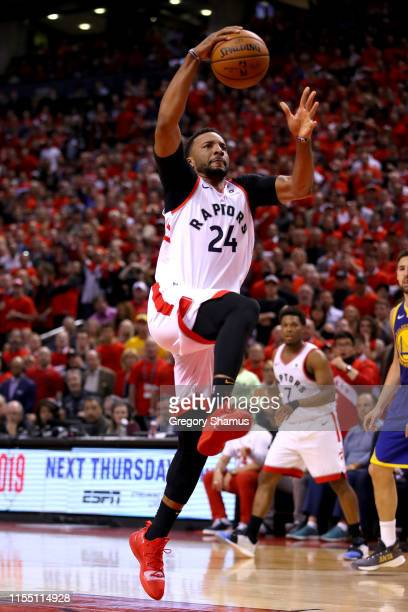 Norman Powell of the Toronto Raptors dunks the ball against the Golden State Warriors in the second half during Game Five of the 2019 NBA Finals at...