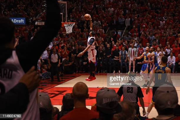 Norman Powell of the Toronto Raptors dunks the ball against the Golden State Warriors during Game Five of the NBA Finals on June 10 2019 at...