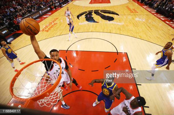Norman Powell of the Toronto Raptors dunks the ball against the Golden State Warriors during Game Two of the 2019 NBA Finals at Scotiabank Arena on...