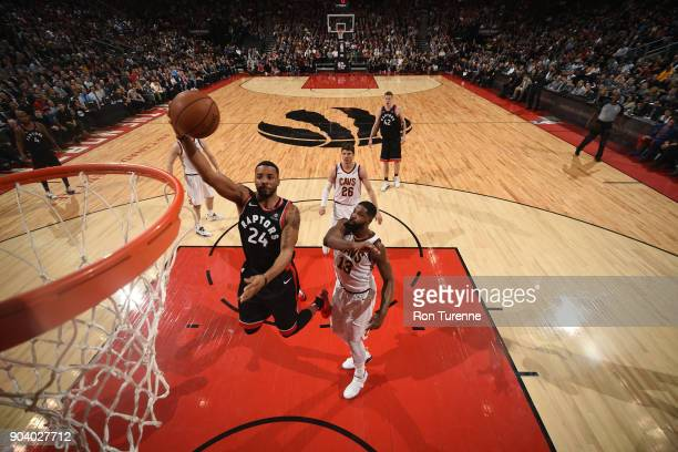 Norman Powell of the Toronto Raptors goes to the basket against the Cleveland Cavaliers on January 11 2018 at the Air Canada Centre in Toronto...