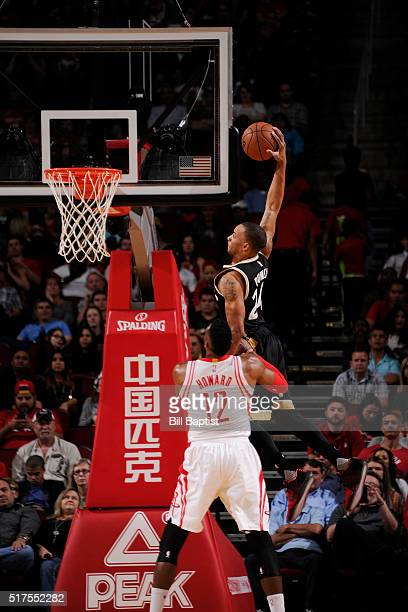 Norman Powell of the Toronto Raptors goes up for a dunk against the Houston Rockets on March 25 2016 at the Toyota Center in Houston Texas NOTE TO...