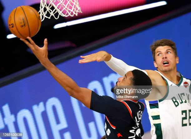 Norman Powell of the Toronto Raptors goes up for a shot against Kyle Korver of the Milwaukee Bucks during the second quarter at The Field House at...
