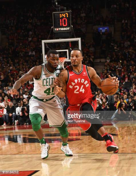 Norman Powell of the Toronto Raptors handles the ball against Kadeem Allen of the Boston Celtics on February 6 2018 at the Air Canada Centre in...