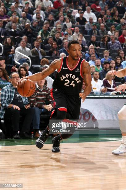 Norman Powell of the Toronto Raptors handles the ball against the Milwaukee Bucks on October 29 2018 at Fiserv Forum in Milwaukee Wisconsin NOTE TO...