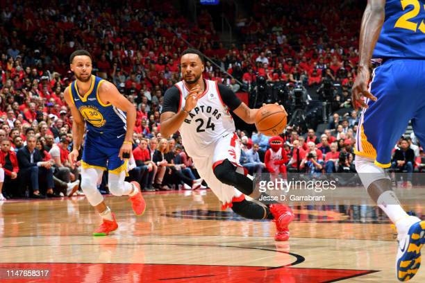 Norman Powell of the Toronto Raptors handles the ball against the Golden State Warriors during Game Two of the NBA Finals on June 2 2019 at...