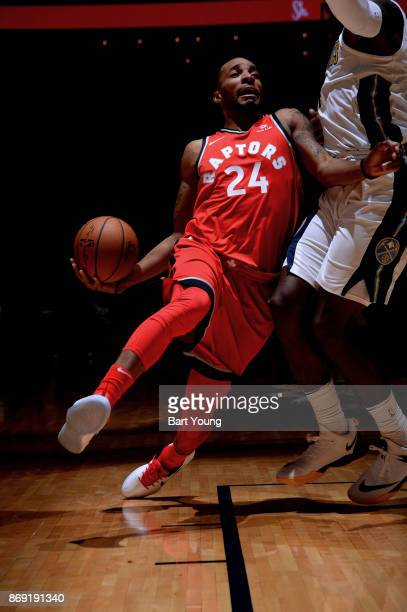 Norman Powell of the Toronto Raptors handles the ball against the Denver Nuggets on November 1 2017 at the Pepsi Center in Denver Colorado NOTE TO...