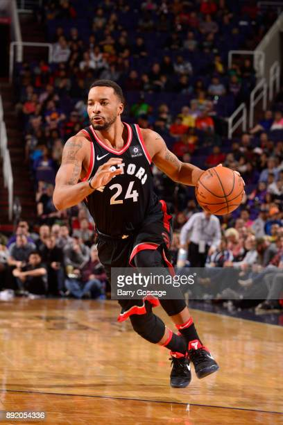 Norman Powell of the Toronto Raptors handles the ball against the Phoenix Suns on December 13 2017 at Talking Stick Resort Arena in Phoenix Arizona...