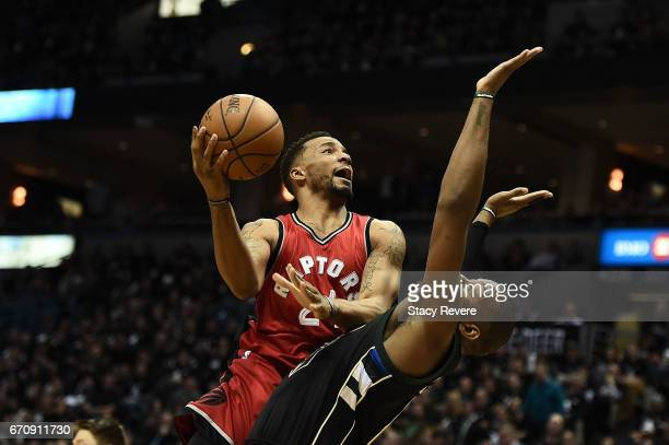 Norman Powell of the Toronto Raptors is fouled by Greg Monroe of the Milwaukee Bucks during the second half of Game Three of the Eastern Conference...