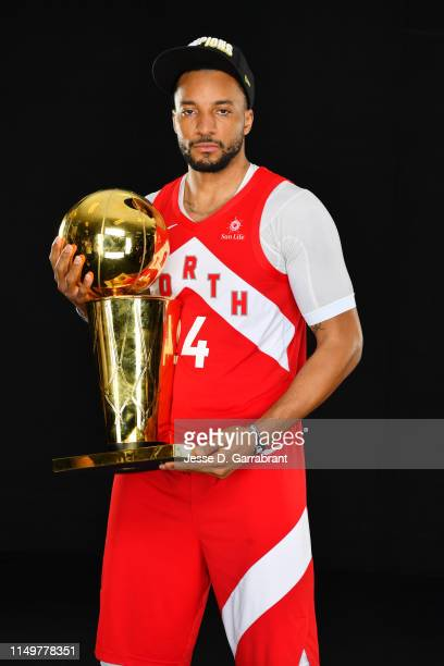 Norman Powell of the Toronto Raptors poses for a portrait with the Larry O'Brien Trophy after winning Game Six of the 2019 NBA Finals against the...
