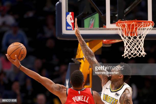 Norman Powell of the Toronto Raptors puts up a shot against Wilson Chandler of the Denver Nuggets at the Pepsi Center on November 1 2017 in Denver...