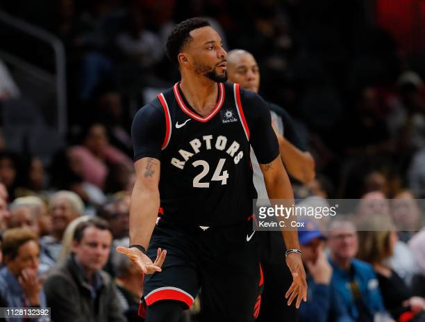 Norman Powell of the Toronto Raptors reacts after hitting a threepoint basket against the Atlanta Hawks at State Farm Arena on February 07 2019 in...
