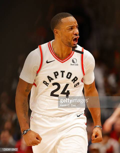 Norman Powell of the Toronto Raptors reacts after hitting a threepoint basket against the Atlanta Hawks in the second half at State Farm Arena on...