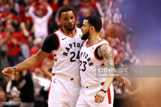 Norman Powell of the Toronto Raptors reacts with Fred VanVleet during the second half against the Milwaukee Bucks in game four of the NBA Eastern...