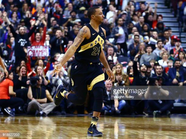 Norman Powell of the Toronto Raptors signals a three pointer during the second half of an NBA game against the Portland Trail Blazers at Air Canada...