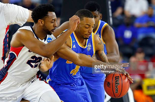 Norman Powell of the UCLA Bruins brings the ball up the floor as Byron Wesley of the Gonzaga Bulldogs defends during a South Regional Semifinal game...